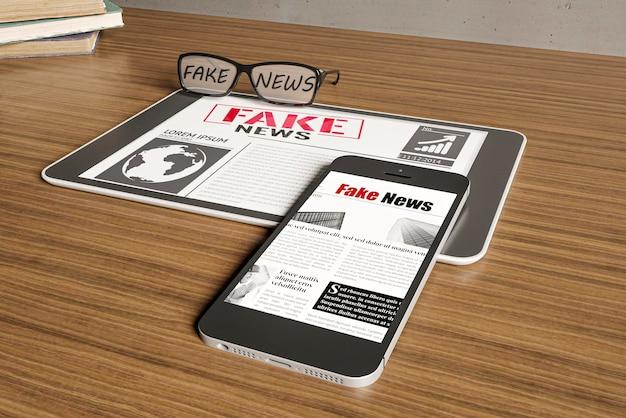 High angle of glasses and smartphone with fake news