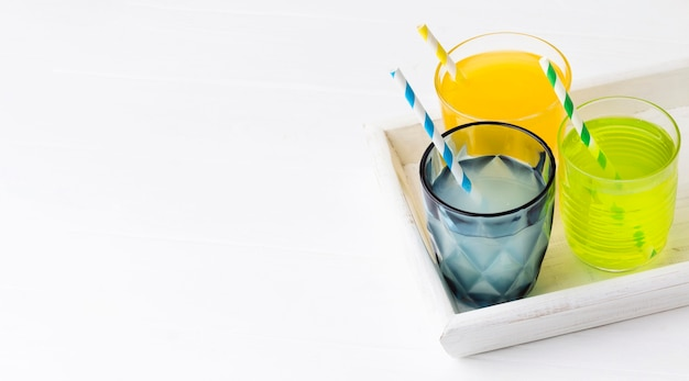 High angle of glasses with soft drinks and copy space