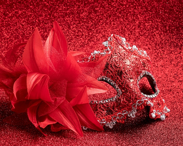 High angle of glittery carnival mask with feathers