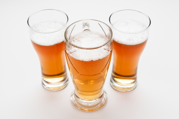 High angle golden beer glasses