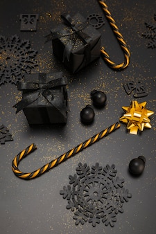 High angle of golden candy cane and christmas presents