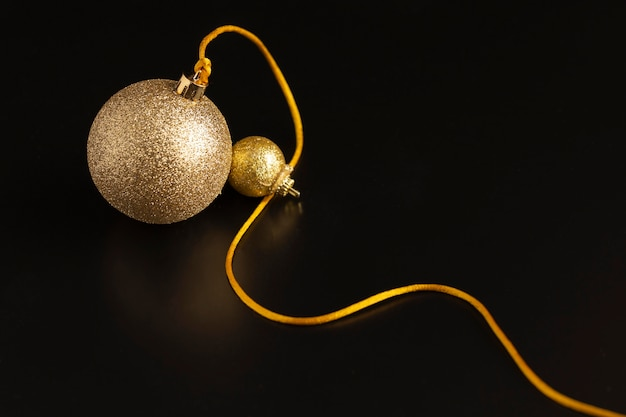 High angle of golden christmas globe with string
