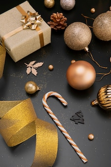 High angle of golden christmas ornaments and decorations with ribbon