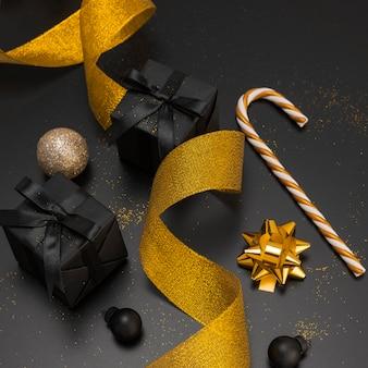High angle of golden ribbon and christmas presents