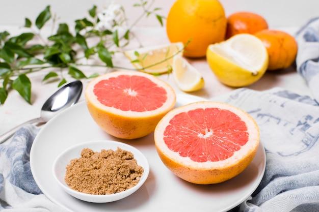 High angle of grapefruit sliced on plate