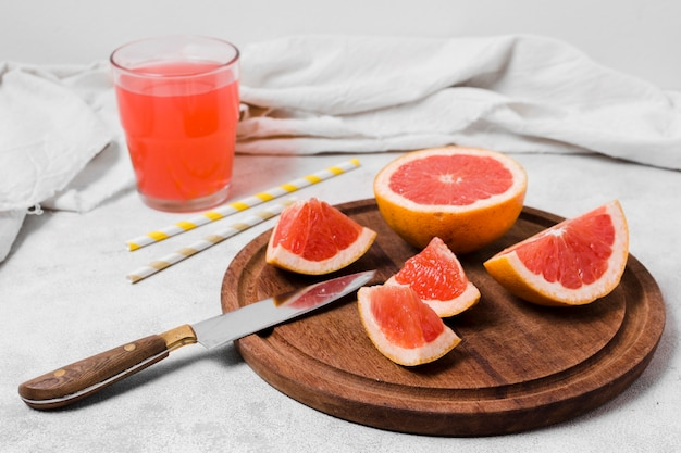 High angle of grapefruit slices with juice