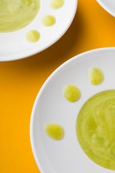 High angle green cream soups