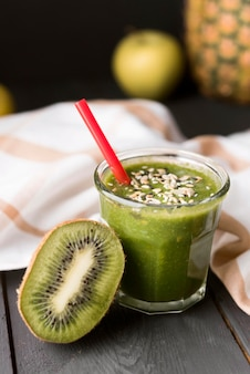 High angle green smoothie with seeds