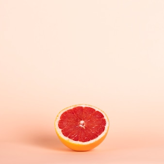High angle half red orange with copy-space