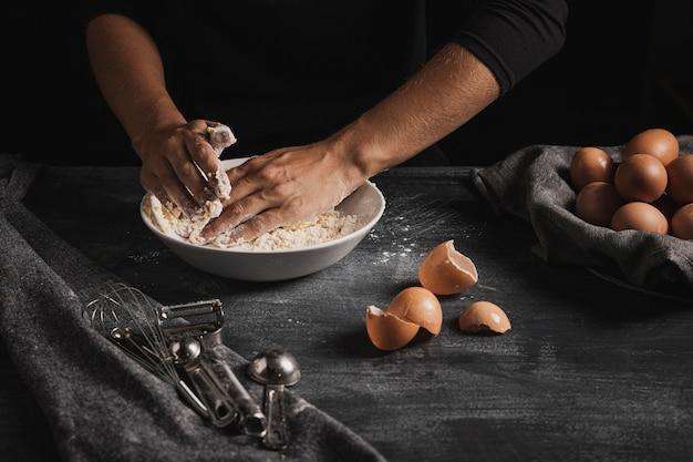 High angle hand mixing dough