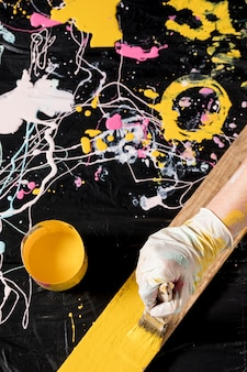 High angle of hand painting with brush