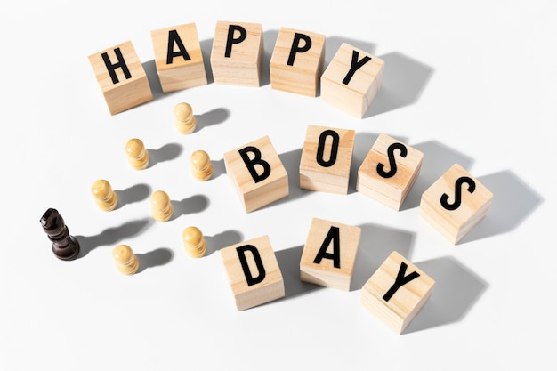 High angle happy boss day chess pieces