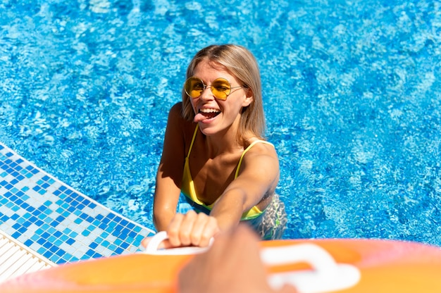 High angle happy woman in pool