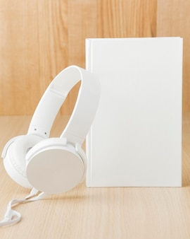 High angle headphone beside book