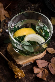 High angle hot water with lemon and leaves
