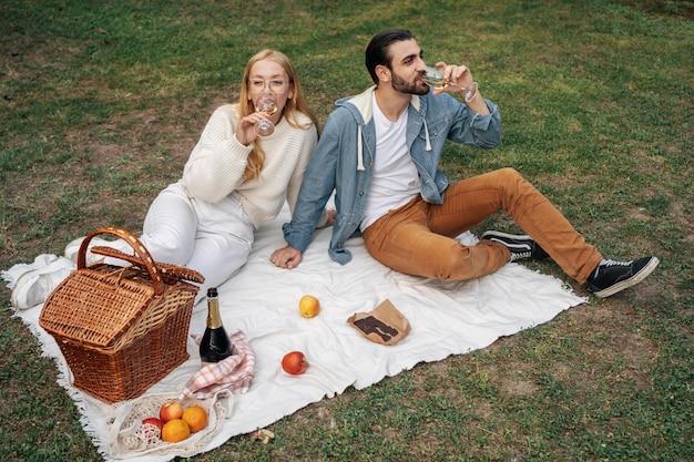 High angle husband and wife having a picnic together