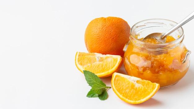 Vaso alto con marmellata di arance