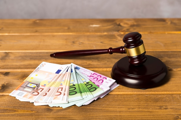 High angle judge gavel with euro banknotes