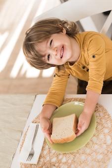 High angle kid having breakfast