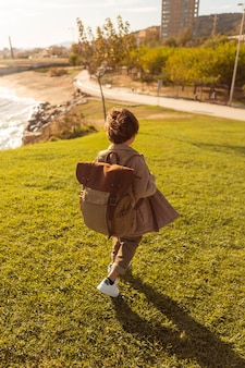 High angle kid wearing backpack