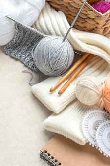 High angle of knitting set with yarn and needles