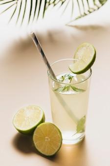 High angle of lemonade glass on plain background