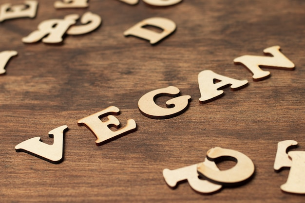 High angle letters composing vegan word