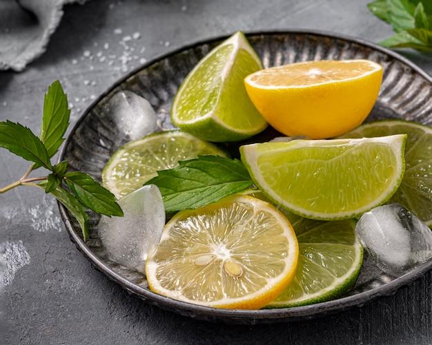 High angle lime and lemon slices on plate