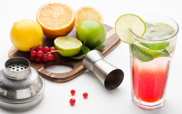 High angle long drink with fruits on cutting board