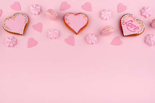 High angle of macarons and heart-shaped cookies for valentines day