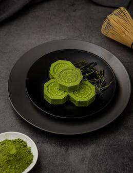 High angle of matcha tea on plate with herbs