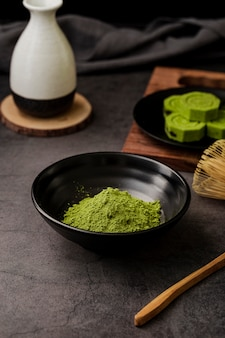 High angle of matcha tea powder in bowl