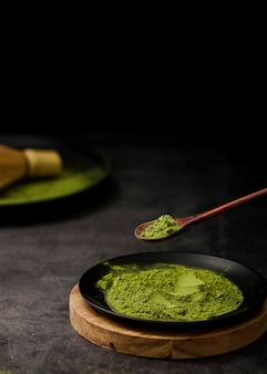 High angle of matcha tea powder on plate