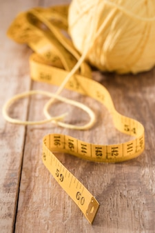 High angle of measuring tape with thread