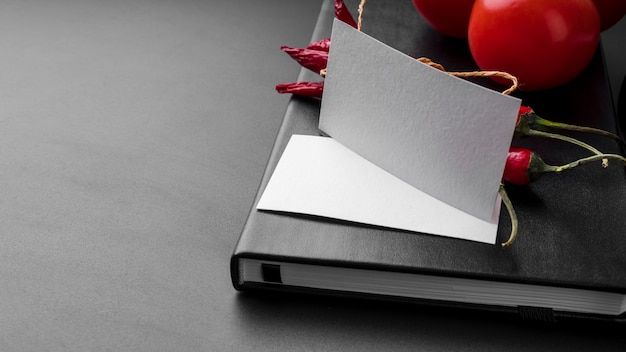High angle of menu book with chili peppers and tomatoes