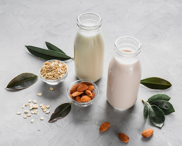 High angle milk bottles with almonds and oats