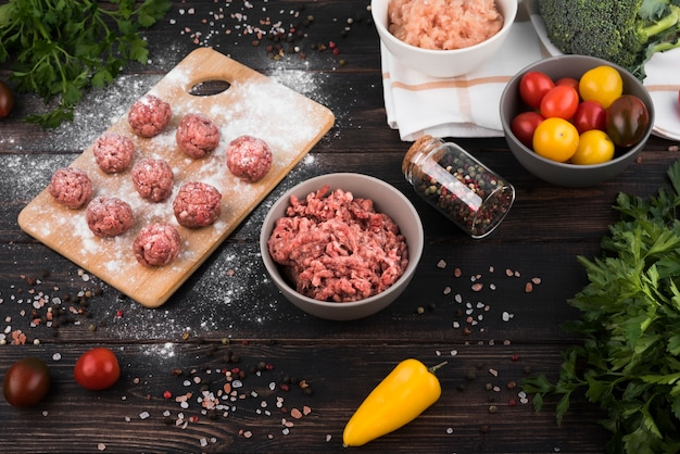 High angle minced meat, meatballs and ingredients