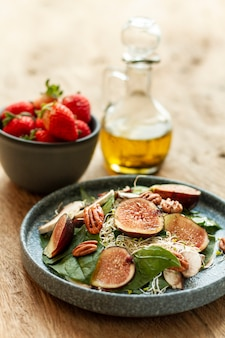 High angle mix of figs and nuts on plate