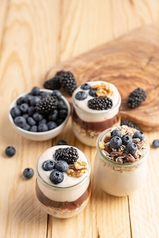 High angle mix of yogurt with berries and oats