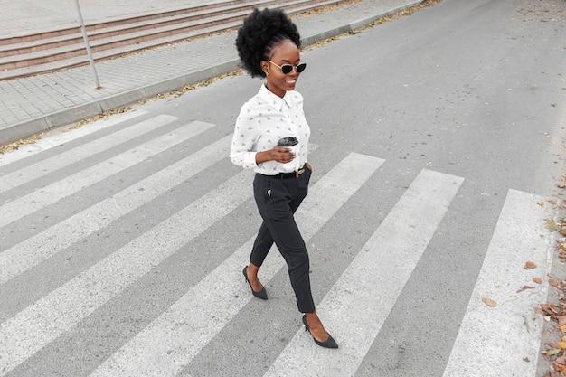 High angle modern woman crossing  crosswalk