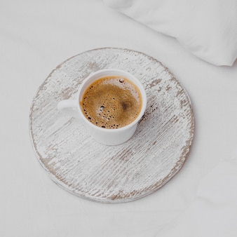 High angle of morning coffee on bed