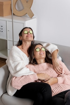 High angle mother and daughter face care