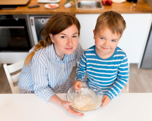 High angle of mother and son cooking