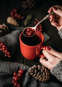 High angle mug with hot drink and cranberries