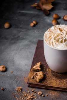 High angle mug with hot drink and whipped cream