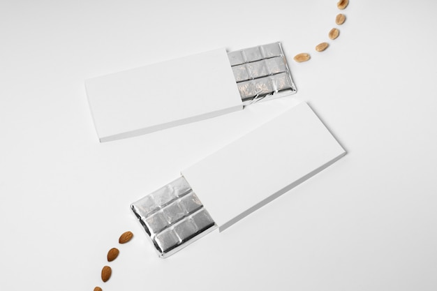 High angle of multiple blank chocolate bars packages with foil and nuts