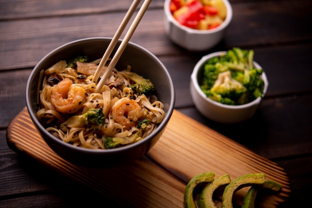 High angle of noodles in bowl with shrimp