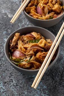 High angle noodles in bowls with copy space