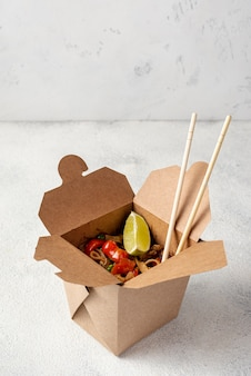 High angle noodles takeaway with chopsticks