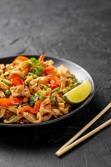 High angle noodles with vegetables and chicken